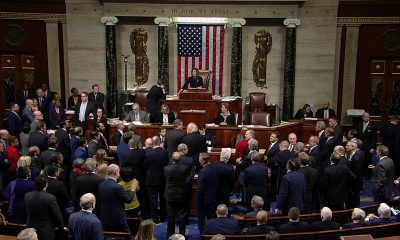 90008af2-1200px-house-of-representatives-votes-to-adopt-the-articles-of-impeachment-against-donald-trump
